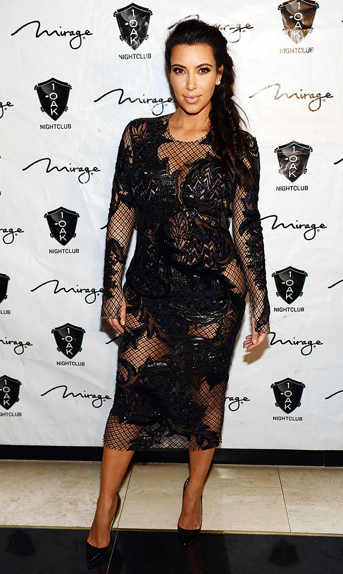 Va-va voom! Kim arrives at the New Year's Eve countdown at 1 OAK Nightclub at The Mirage  on Dec. 31, 2012 in Las Vegas wearing a peek-a-boo mesh dress that ensures all eyes are on her.