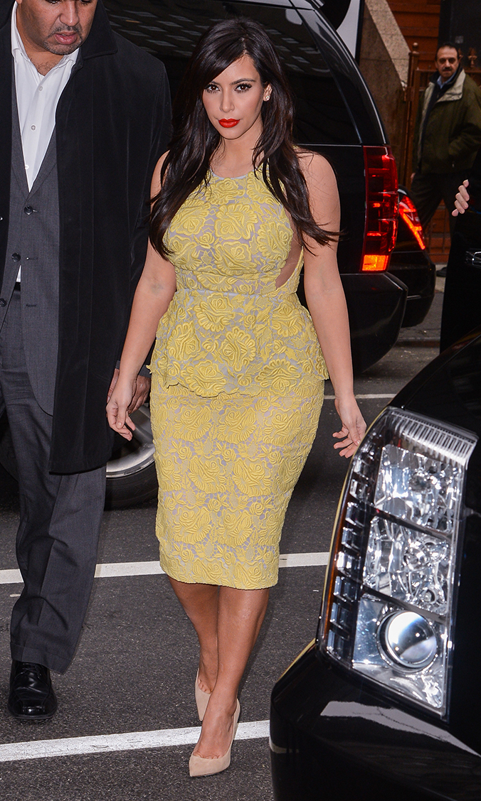 For her Today Show taping on Jan. 15., Kim chooses a snug, knee-length dress with a yellow leaf print and adds drama with a blood-orange lip.