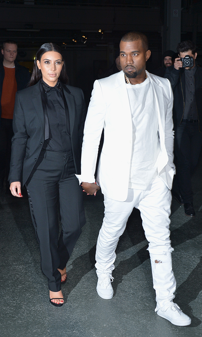 Talk about a power couple! Kim and Kanye go monochrome in matching black and white suits as they attend the Givenchy  Fall/Winter 2013 Ready-to-Wear show as part of Paris Fashion Week on March 3.