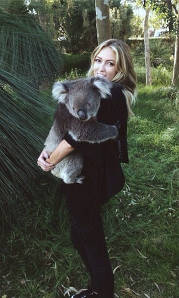 "We can't decide who's cuter! Paulina Gretzky hugs an adorable koala bear in Australia, posting the snap to her Instagram account with the caption: ""Got to meet Sunshine the Koala today!! All thanks to my amazing fiancé @djohnsonpga!"""