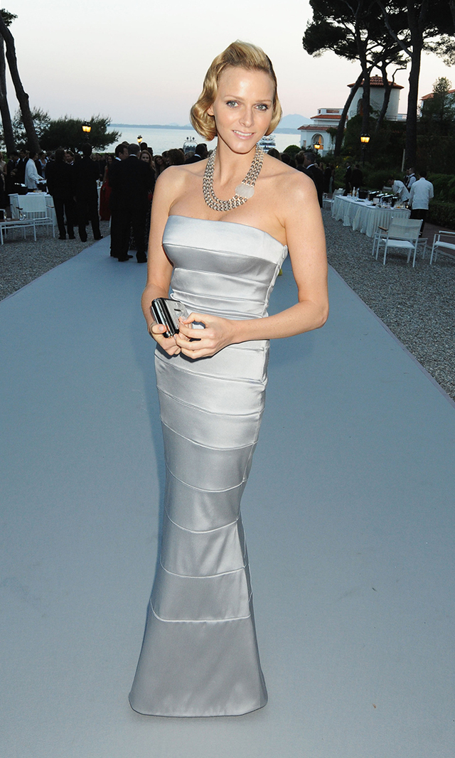 Charlene made her dazzling society debut at the amfAR's Cinema Against AIDS benefit gala in May, 2010, wearing a strapless silver dress and her hair swept into a Veronica Lake-inspired 'do.