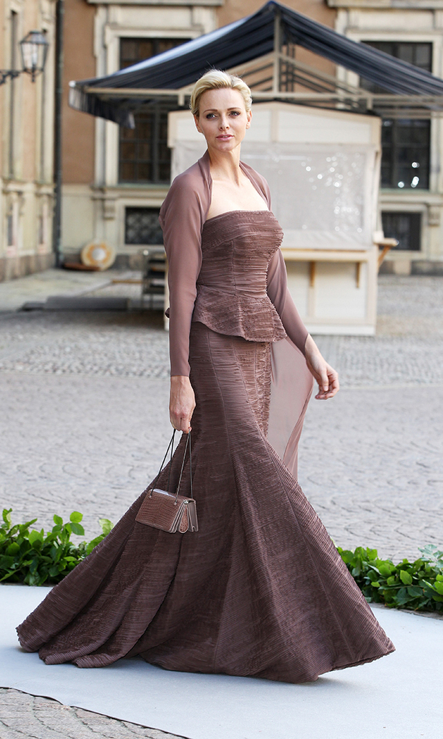 The princess turned heads at Princess Madeleine and Christopher O'Neill's wedding on June 8, 2013, in a taupe gown by Akris, one of her favourite designers. Unlike her royal counterparts, Charlene forewent her tiara and jewels.