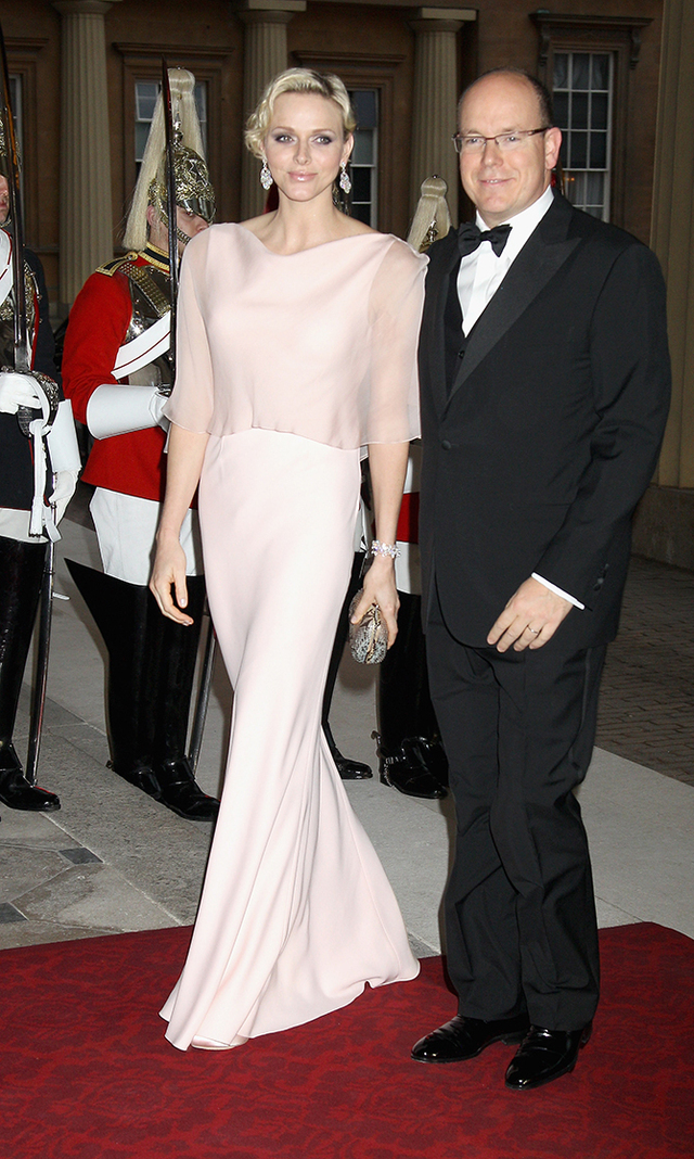 For a 2012 dinner hosted by Prince Charles and Camilla, Charlene slipped into an elegant, pale pink ensemble, which complemented her fair-haired complexion beautifully.