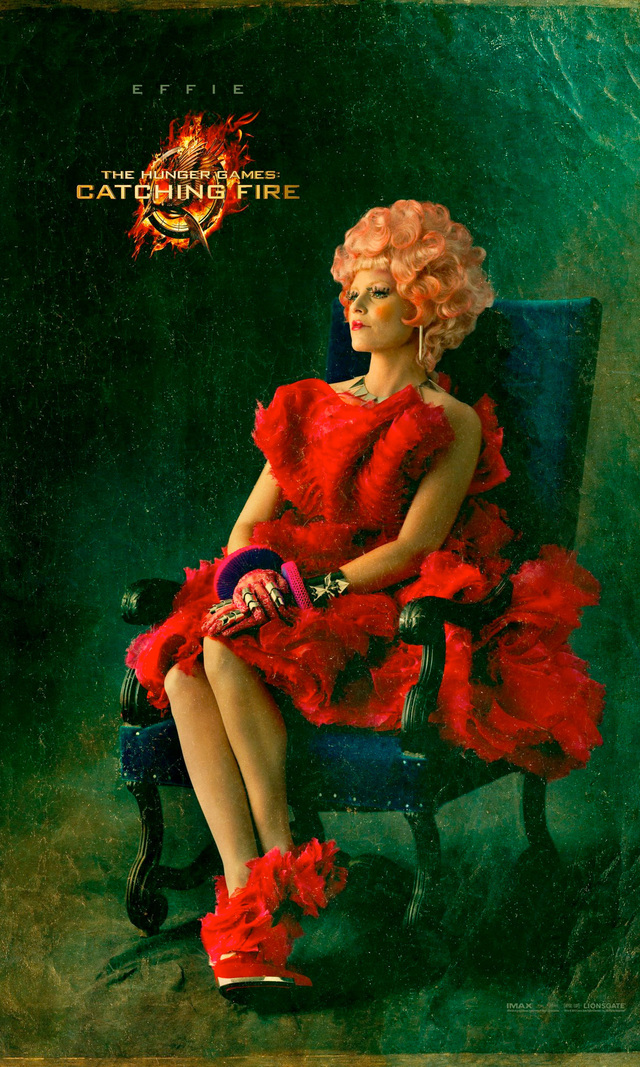 EFFIE TRINKET (Elizabeth Banks): The upbeat, pink-haired escort of the tributes, Effie represents the Capitol's emphasis on superficiality and excess to a tee.