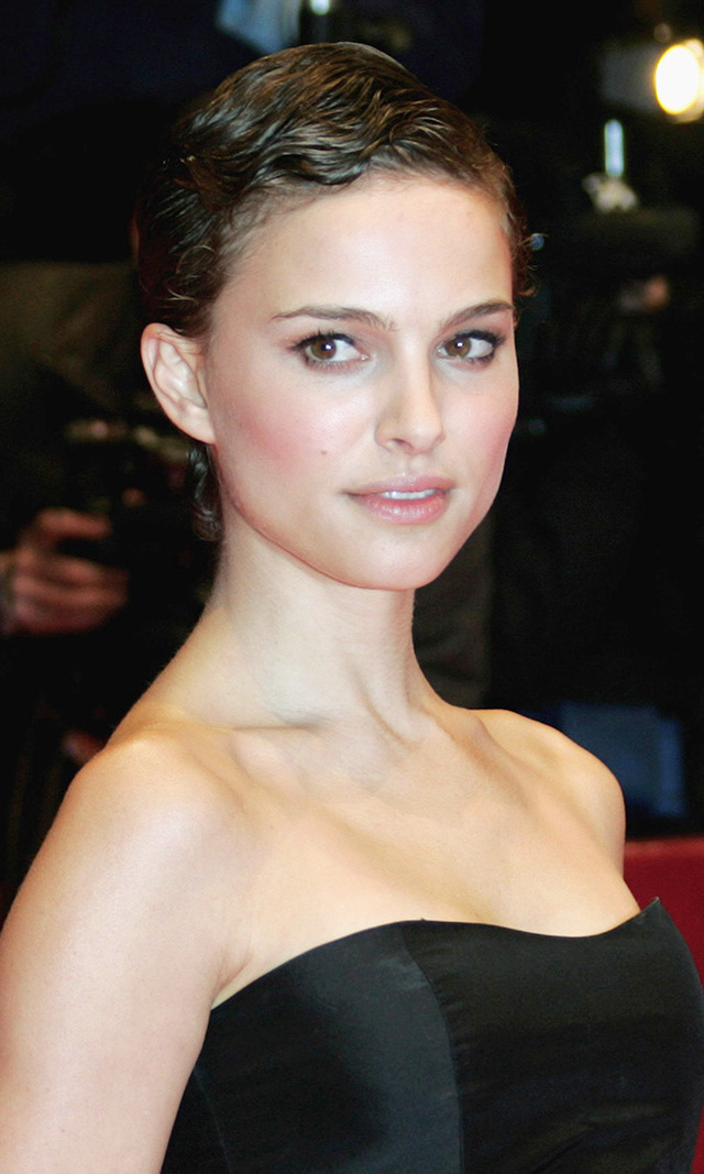"The year was 2005, and Natalie Portman was filming the politically charged action-drama 'V for Vendetta,' when the entertainment world was suddenly thrown into a frenzy: The then-24-year-old actress was spotted with a buzz cut! ""It was a one-shot deal, and that was the most stressful thing about the experience,"" she told USA Today about filming the scene in which she actually has her head shaved. By this time, at the Berlin International Film Festival in 2006, Natalie's hair had grown into a pretty pixie."