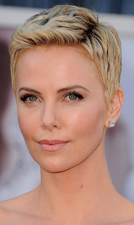 Kristen Chenoweth recently cited Charlize Theron as part of the inspiration behind her own pixie cut, and we can certainly see why! Charlize got a buzz cut in 2012 for 'Mad Max 4: Fury Road,' and debuted a pretty blond pixie (with dark roots) at the 2013 Oscars - complete with a peplum-style white Dior gown and some serious arm candy. She recently had to go under the shaver again for reshoots, which she was reportedly not thrilled about (it took three months to get her hair to this stage!).