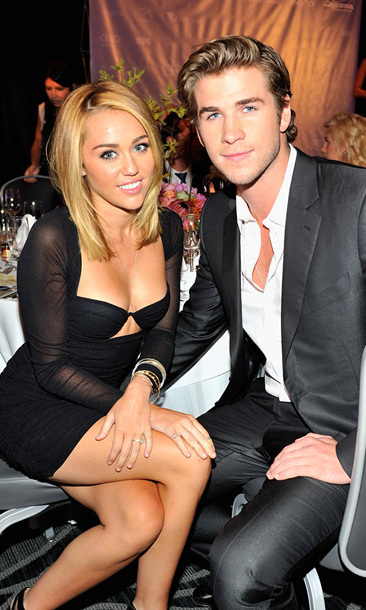 By June 2012, Miley had begun to embrace a different look. After cutting her hair into a chic bob, she announced her engagement to 'The Hunger Games' actor Liam Hemsworth. The couple, pictured here at a Benefit dinner, met on the set of 'The Last Song,' in which they starred as lovers.