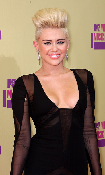 Then, the transformation begins. Miley debuts her newly chopped, bleached blond locks worn in an edgy bouffant style at the 2012 MTV Video Music Awards in September.