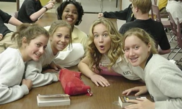 She hasn't changed a bit! One of Jennifer Lawrence's ex classmates shared this goofy photo of the Oscar-winner (centre) in high school. Photo credit: Reddit/miloblue12