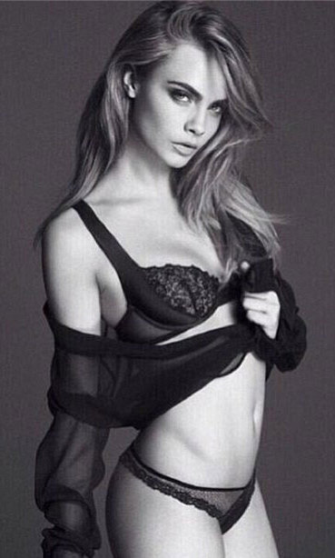 Cara Delevingne uploaded this sexy photo to her Instagram account, which shows the model wearing la Perla lingerie.