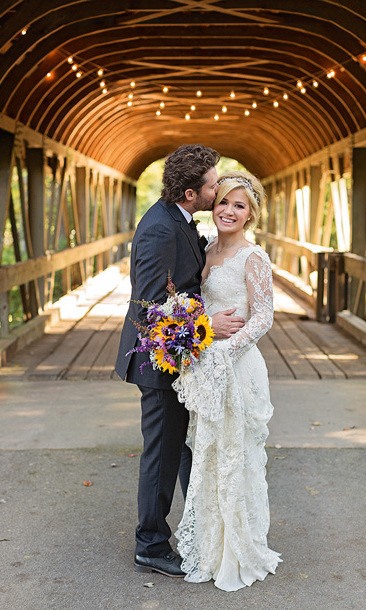 KELLY CLARKSON AND BRIAN BLACKSTOCK: Kelly Clarkson delighted fans when she revealed that she had secretly tied the knot with fiancé Brian Blackstock in late October. The singer shared several photos of the romantic, rustic ceremony on Twitter, including this beautiful snap, which shows her happy husband planting a kiss on her cheek.