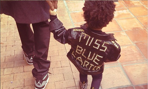 "Beyonce uploaded this adorable photo of Blue Ivy to her Instagram page on Dec. 4, which shows her daughter rocking a studded ""Miss Blue Carter"" leather jacket, skinny jeans and floral Dr. Martens while holding daddy Jay-Z's hand."