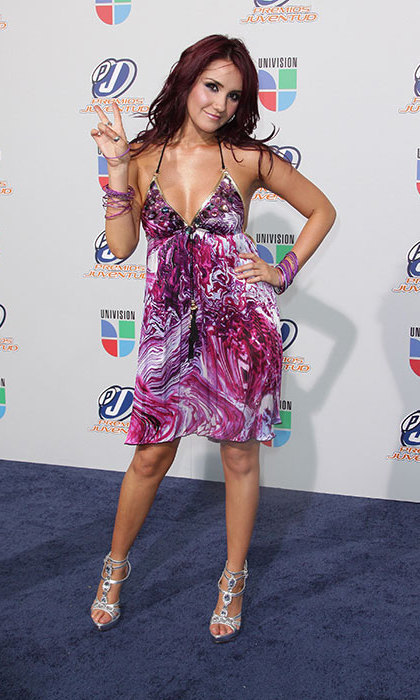 Opting for a more streamlined second look at the 2010 Univision Premios Juventud Awards, Frida Kahlo's great-niece let the pattern on her pink-and-white dress bring the noise. She paired the frock with a glitzy pair of silver sandals.
