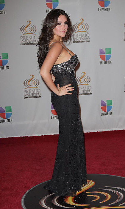Glamour reigns Dulce's look in a dress dripping with sequins at the 2012 Premio Lo Nuestro a la Musica Latina, an awards show honouring the best in Latin music, in Miami.