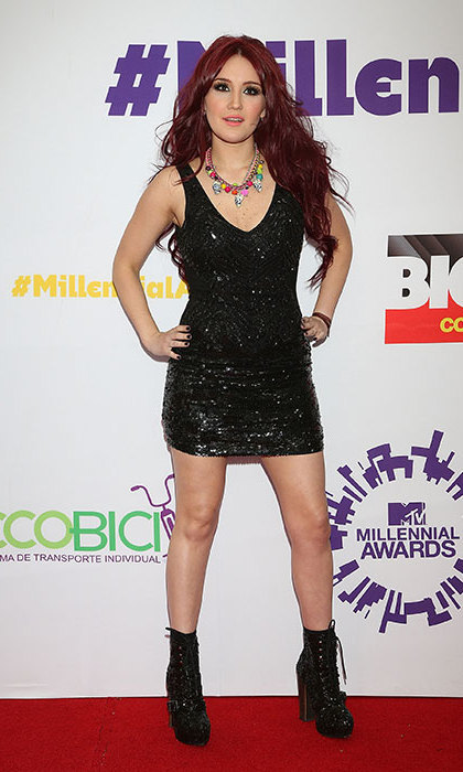 At the MTV Millennial Awards in 2013, where the pop princess picked up the award for best presence on Twitter, a black mini dress and black boots had some fun with a brightly coloured necklace, complete with dangling skulls.