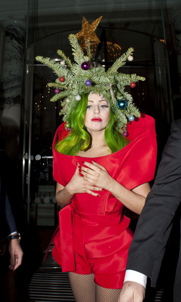Lady Gaga got into the holiday spirit over the weekend by dressing up as a Christmas tree after playing a private gig in London.