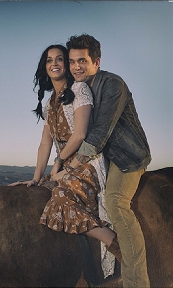 "Forget Kanye and Kim's motorcycle ride - John Mayer and Katy Perry are keeping things decidedly more PG! John shared this behind-the-scenes shot on Instagram, a still from the music video for his duet with girlfriend Katy. The video for ""Who You Love"" is officially out... and it's cuddly!"
