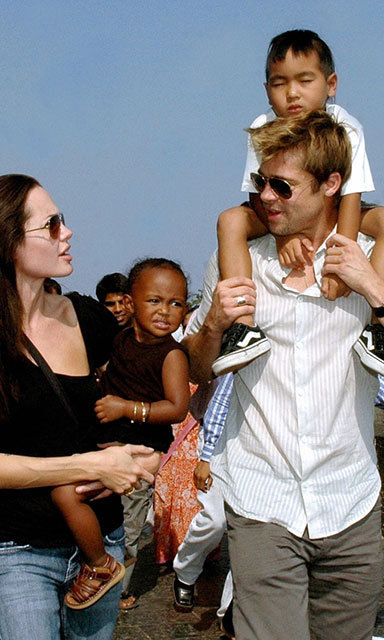 Angelina, daughter Zahara, son Maddox and Brad were photographed enjoying a relaxing stroll together on the seafront promenade in Mumbai in 2006.