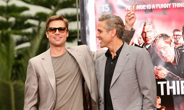 Costars Brad Pitt and George Clooney enjoyed a laugh together during the 'Ocean's Thirteen' Handprint and Footprint Ceremony in 2007.