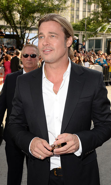 Donning a dark suit and a ponytail, Brad Pitt looked very dapper indeed at the 2013 '12 Years A Slave' premiere at the Toronto International Film Festival.