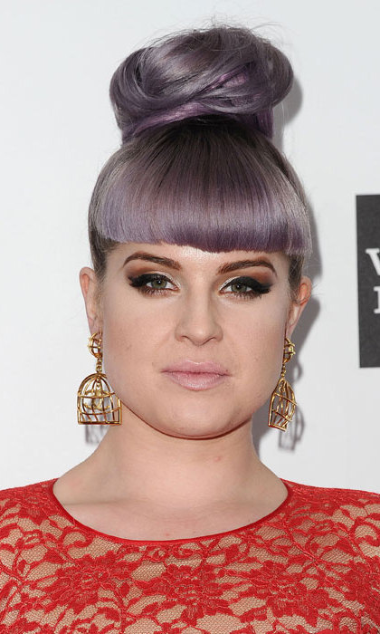 "Kelly Osbourne cut her purple grey hair into a fringe.  ""Just cut a fringe aka bangs what do you guys think? I love them!!!"" she said alongisde an Instagram shot of her new 'do. The post quickly garnered likes and the count hit over 10,000 just half an hour. Photo: © Getty Images"
