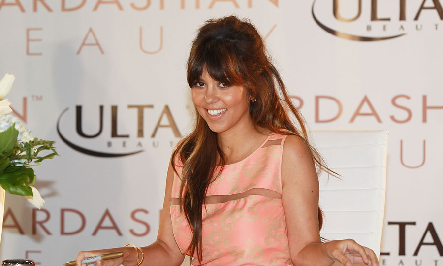 Back in March, Kourtney Kardashian debuted a fringe along with a new honey hue. Photo: © Getty Images