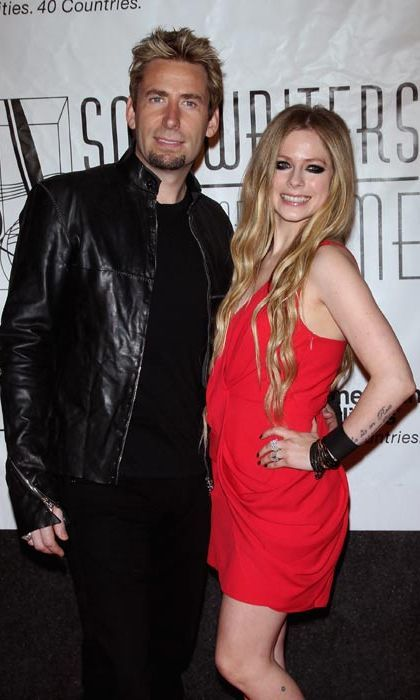 "Chad Kroeger & Avril Lavigne  Avril Lavigne and Nickelback frontman Chad Kroeger cemented their whirlwind romance when they tied the knot in the south of France on 1 July, 2013.  The couple had been dating for one month when they got engaged in August 2012.  Prior to her romance with Chad, Avril was married to another musician, Sum 41's Deryck Whibley. They exchanged vows in July 2006 - but the union lasted just three years.  ""I am grateful for our time together, and I am grateful and blessed for our remaining friendship,"" Avril said following their divorce.   Photo: © Getty Images"