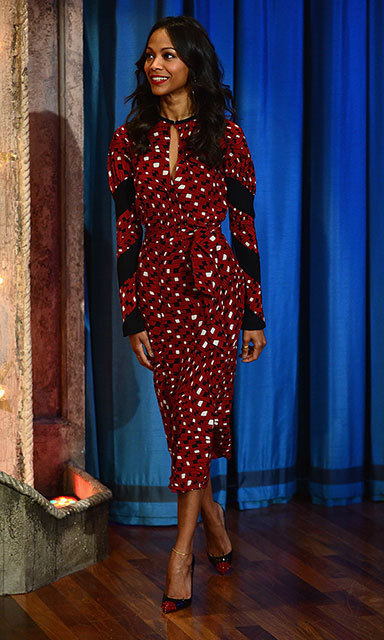"Zoe Saldana made a glamorous appearance on 'Late Night With Jimmy Fallon"" in 2013 in a red-and-black patterned outfit with matching shoes."