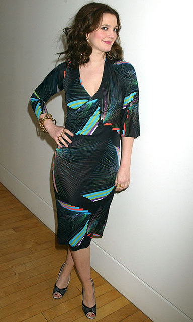 For a 2005 appearance on MTV's 'TRL', Drew Barrymore accessorized her retro-inspired dress with funky gold jewelry.