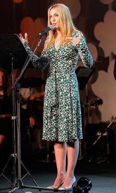 An unusually demure Madonna spoke about spirituality for a kids event in 2004 in Tel Aviv wearing a sophisticated, long-sleeved wrap dress.
