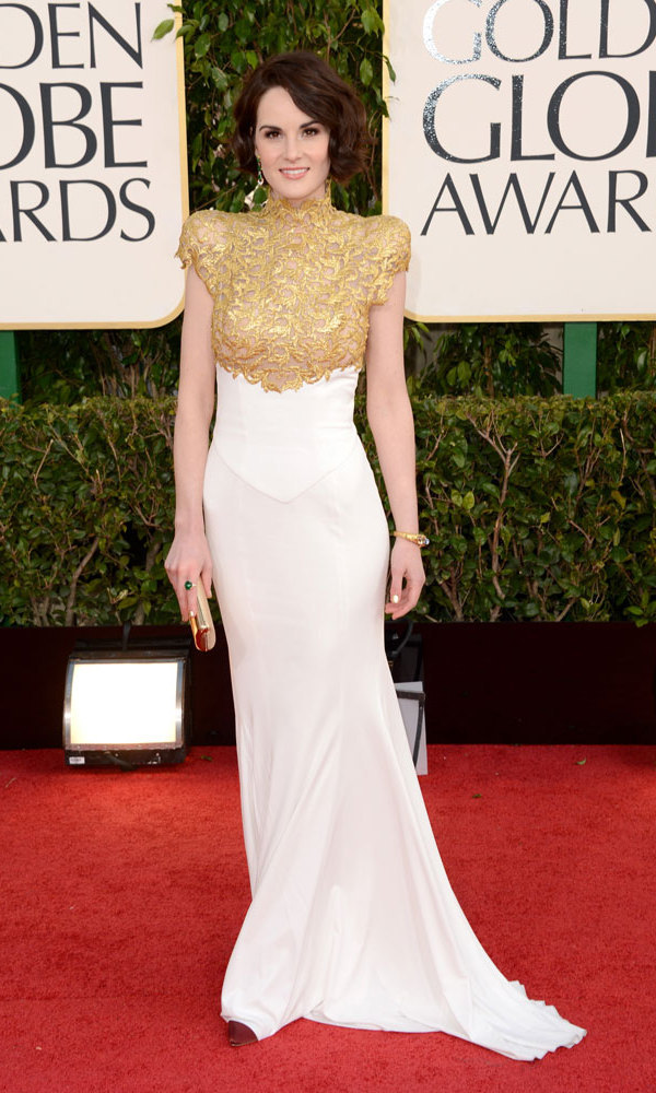 MICHELLE DOCKERY: White can be unforgiving at times, but we'll forgive Michelle Dockery all her character's misgivings in this ultra-flattering Alexander Vauthier gown – regal and embellished on top, sleek and figure-flattering down below.