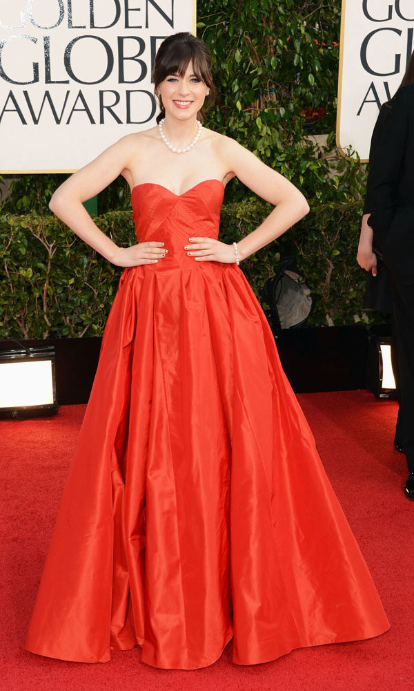 ZOOEY DESCHANEL: The 'New Girl' star traded her cute wardrobe on the hit TV show for a ravishing red Oscar de la Renta gown and prim pearl accessories (though her nail art – tiny cameras and film reels – lent her look some levity).