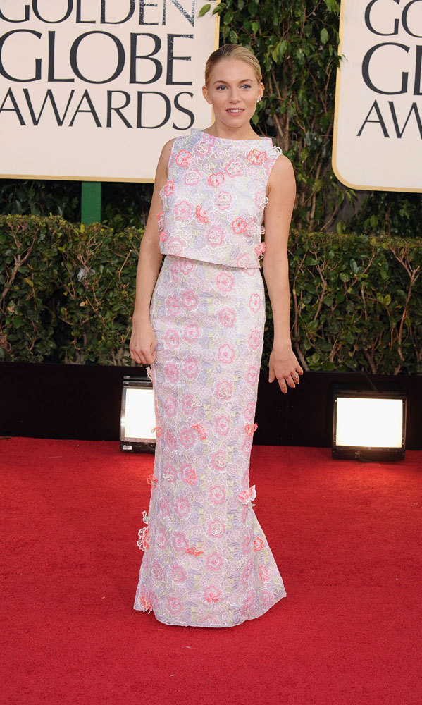 SIENNA MILLER: British fashion plate and Golden Globe nominee Sienna Miller took a risk last year and, as usual, came out on top! Her floral top and skirt by Montreal-born Erdem Moralioglu was unlike any other look, and the soft palette was perfectly complimented by Sienna's fresh face and simple hair.