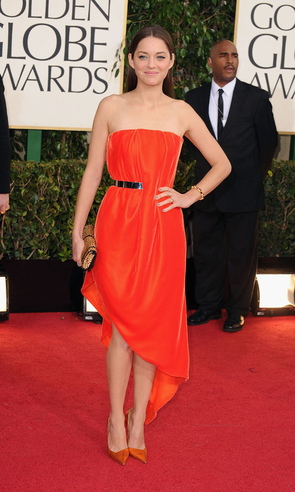 MARION COTILLARD: The stunning French Dior model and nominee for 'Rust and Bone' wore an orange number from the iconic fashion house's haute couture collection, an avant-garde, strapless look with a metal belt only half exposed and an asymmetrical hemline.