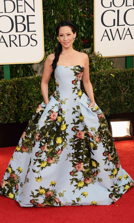 LUCY LIU: Fabulous florals were in short supply in 2013, but Lucy Liu walked the red carpet in a voluminous, sky-blue Carolina Herrera ball gown boldly patterned with yellow and pink flowers and green vines. We also fell hard for her fishtail braid!