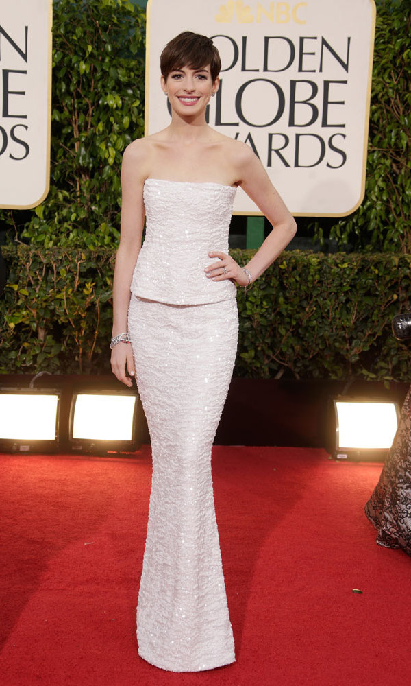 ANNE HATHAWAY: We certainly wouldn't change the channel with this Chanel column gown on the screen. With her 'Les Miserables'-spawned pixie cut in tow, the Best Actress winner went white on the carpet in a spectacularly simple look that gives the illusion of a skirt-top combo.