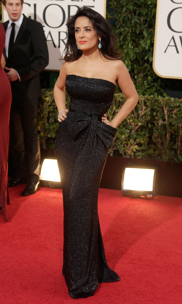 SALMA HAYEK: Va-va-voom! Salma never fails to pull out all the stops (and the sex appeal!) at awards shows, and this strapless Gucci gown is no exception. The black fabric is seemingly dusted with glitter, perfect for bringing the glitz to a glamorous affair!