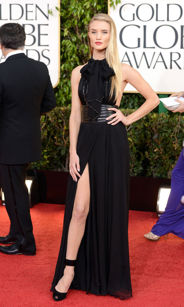 ROSIE HUNTINGTON-WHITELEY: She may have starred in 'Transformers,' but Rosie brought a different franchise to mind with this look: Bond girl! The models' black Saint Laurent halter gown cut slightly across the sides of her breasts and showed off her slim stems.