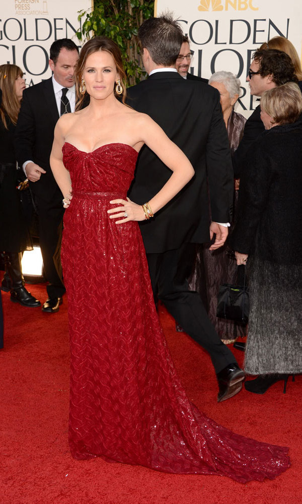 JENNIFER GARNER: Jennifer took a cue from the red carpet itself in this deep-red Vivienne Westwood frock, figure-skimming down to the plush (and coordinated!) ground below. The shimmering gown was full of sex appeal: Cleavage and a nipped waist (need we say more?)
