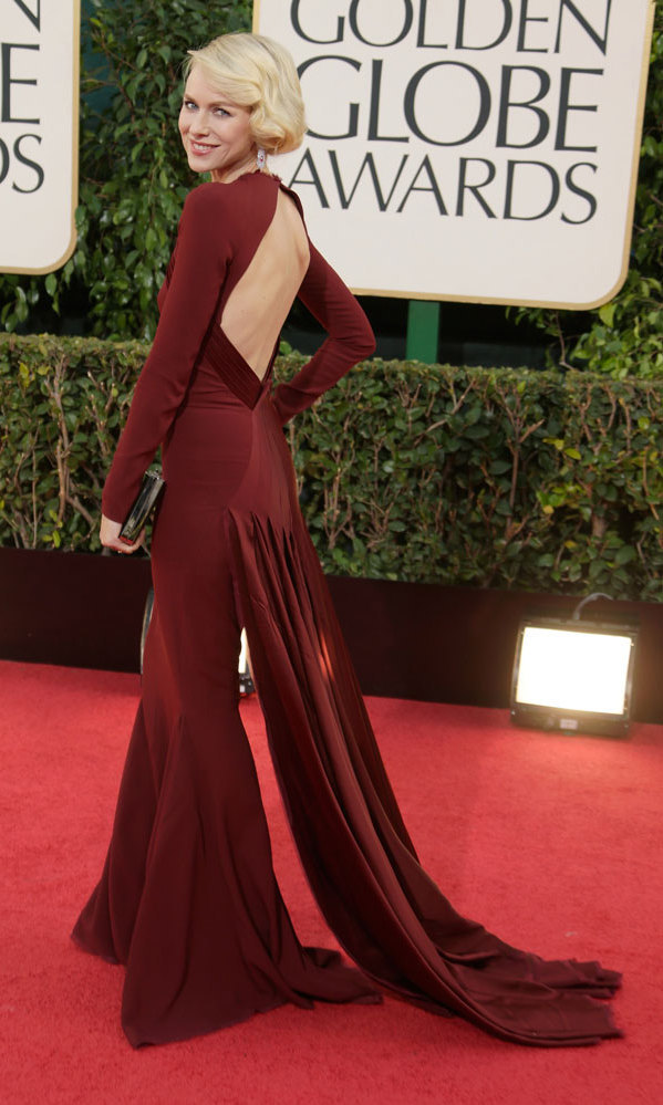 NAOMI WATTS: Quite a few stars covered their arms at the 2013 Golden Globes, among them nominee Naomi Watts. The blond beauty chose Zac Posen's figure-hugging oxblood gown with satin detailing, a peekaboo back and a train that followed the 'The Impossible' actress as she walked the carpet.
