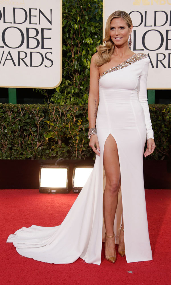HEIDI KLUM: This white, skin-tight Alexander Vauthier gown could pose a number of challenges (least of all not spilling!), but bronzed Heidi pulled it off with ease, showing off her toned legs thanks to a sky-high slit. We love the asymmetrical neckline and single padded shoulder.