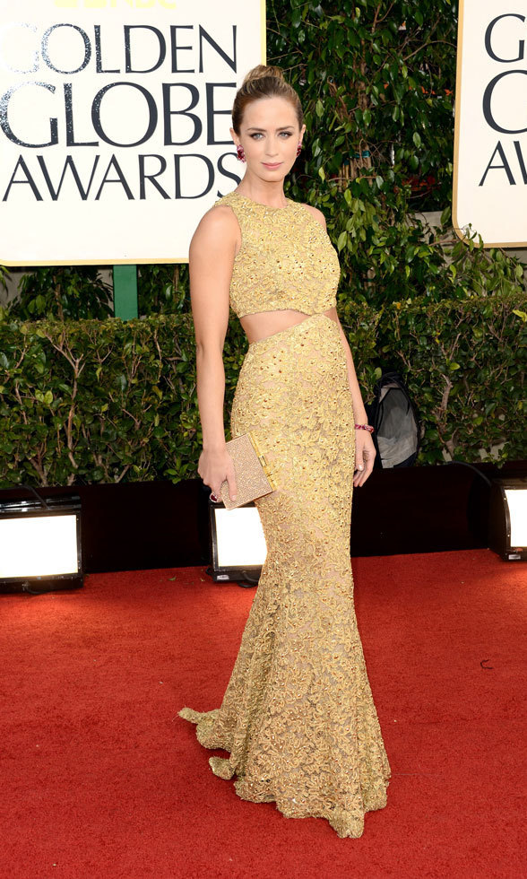EMILY BLUNT: Let's be blunt: Emily was a golden goddess at the Golden Globes. Her studded Michael Kors gown was a radiant yellow-gold hue with cutouts that showed a touch of rib cage and a slice of the actress's back.