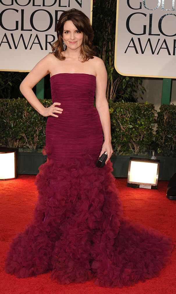 It was burgundy Oscar de la Renta on the red carpet at the 2012 Golden Globes, where Tina's curve-hugging gown gave way to a parade of ruffles.