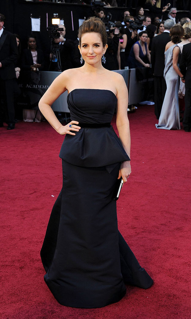 The mom of two made a graceful entrance at the 2012 Academy Awards, wearing a custom Carolina Herrera gown with peplum detail, jewels by Bulgari and a Roger Vivier clutch.