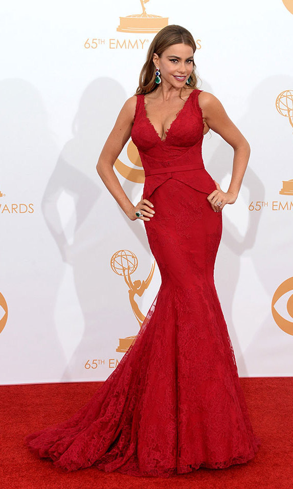 "At the Emmys in 2013, Sofia was the definition of a ""bombshell"" in a red silk gown by Vera Wang and tri-coloured drop earrings, courtesy of Lorraine Schwartz."