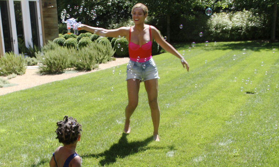 Beyonce teaches Blue how to blow bubbles with flare on a hot summer's day. Photo credit: Beyonce/Tumblr