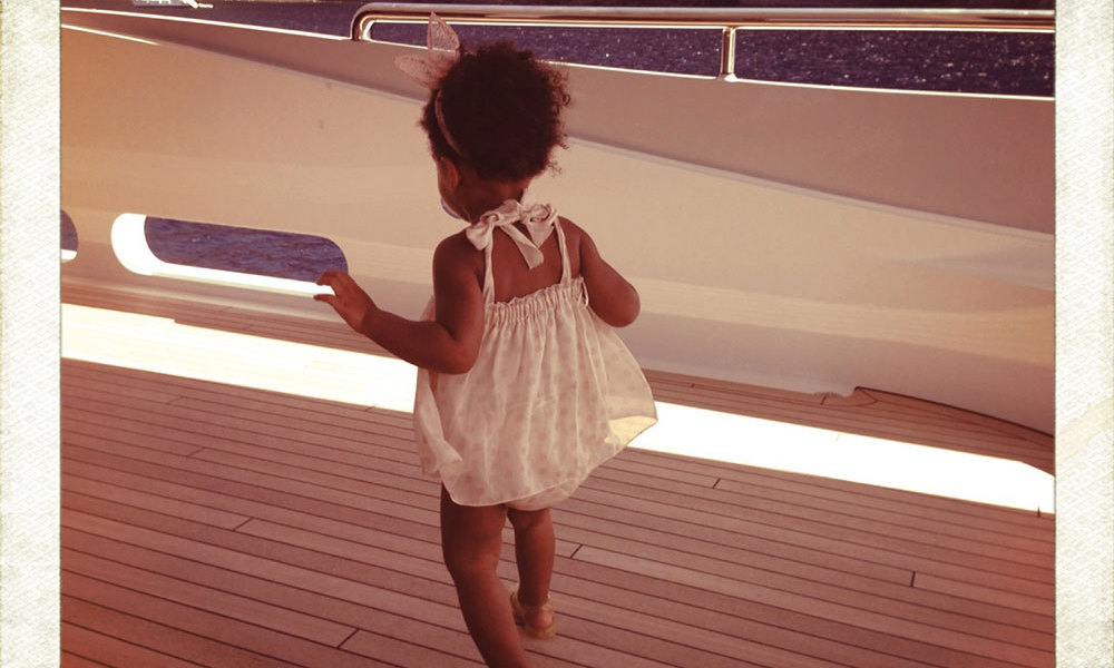 Living the suite life: The precocious youngster is photographed scampering around on mom and dad's yacht wearing pink bunny years and white sun dress. Photo credit: Beyonce/Tumblr