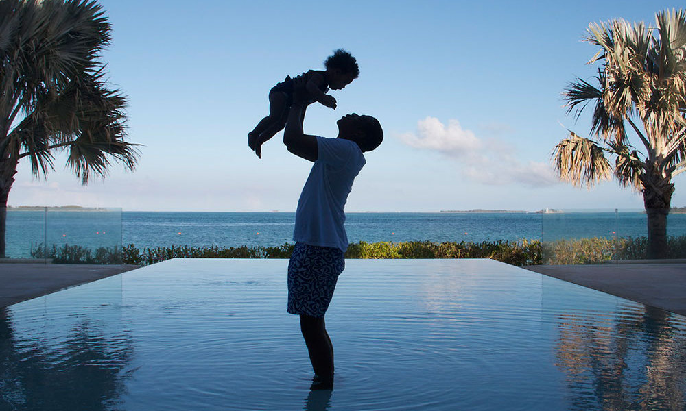 Blue gets a taste of the high life as dad lifts her up in the air for this gorgeous photograph, shot with an infinity pool and palm tress in the backdrop. Photo credit: Beyonce/Tumblr