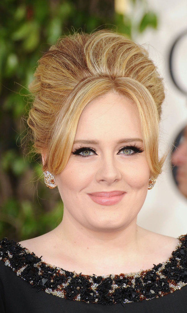 Rocking her usual 1960s-inspired look, Adele complemented her beehive hairstyle with feline liner.