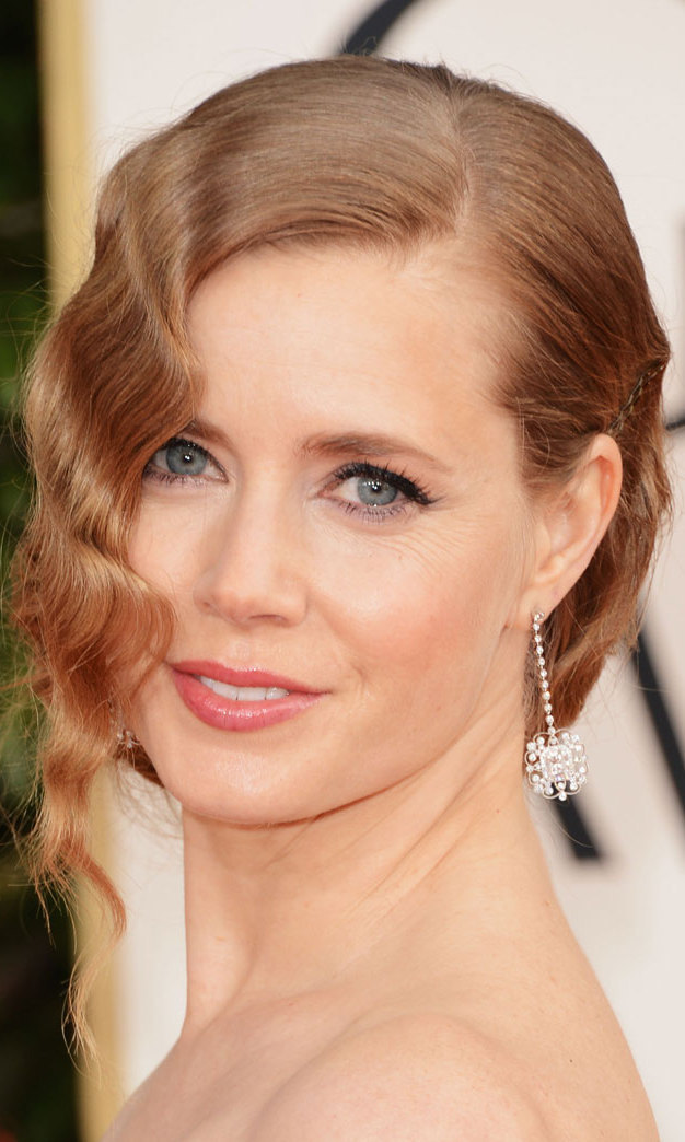 Retro hairstyles were everywhere at the 2013 Golden Globes, and Amy Adams was no exception, opting for a deco-inspired updo complete with 1920s finger waves.